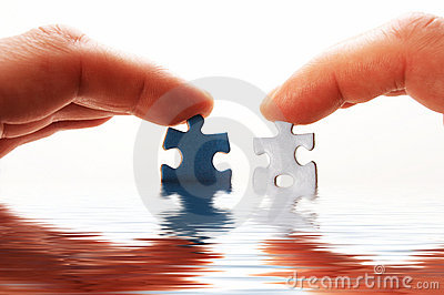 Finger and puzzle in water