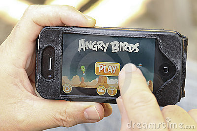 Finger swiping on game on smart phone Editorial Stock Image