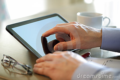 Finger touching screen of a digital tablet