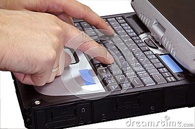 Finger typing on laptop