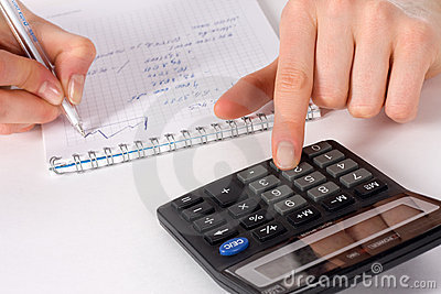 Fingers of girl press on calculator button