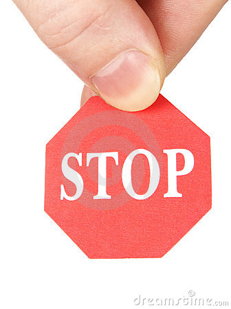 Fingers holding stop sign