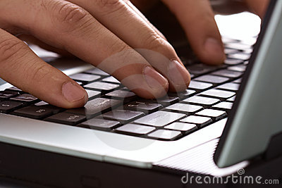 Fingers on the laptop