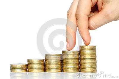 Fingers walking down on stacks of coins