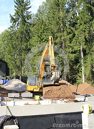 Finland:Sauna Constr. - Excavator Emptying Bucket Editorial Photo