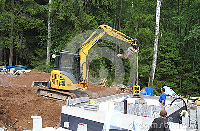 Finl.: Sauna Construction - Excavator/Compactor Editorial Stock Photo