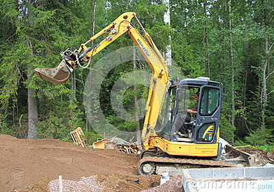 Finland: Sauna Construction - Mini Excavator Editorial Photo