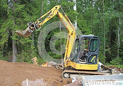 Finland: Sauna Construction - Mini Excavator Editorial Photo