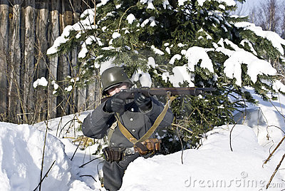 Finnish soldier aims from a rifle