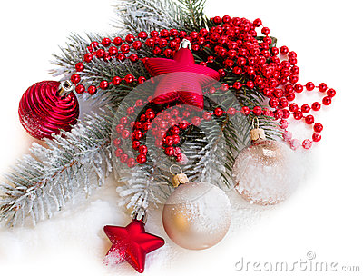 Fir tree branch with christmas decorations