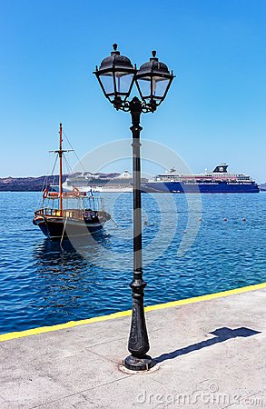 Free Fira, Santorini / Greece - 05-25-2014: Two Large Cruise Ships And An Old Boat In The Small Harbour Of Fira, Santorini, Greece Royalty Free Stock Photo - 124502685