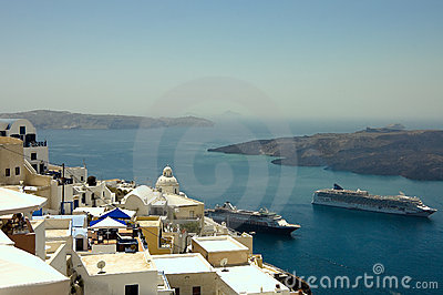 Fira village roofs and boats