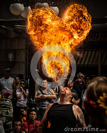 Fire Breather Street Performer and Ball of Flame Editorial Photography