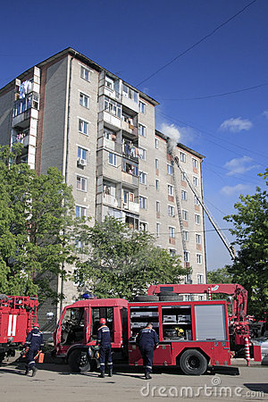 Fire-brigade extinguish a fire  in apartment house
