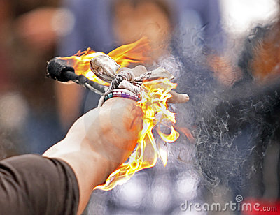 Fire busker juggle arm closeup