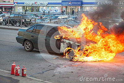 Fire from the car engine hood on city street Editorial Photography