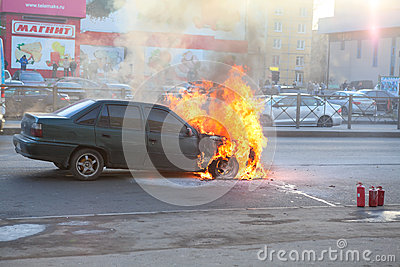 Fire from the car engine hood on city street Editorial Stock Photo