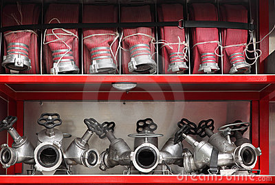 Fire cocks and hoses organized inside fire engine Stock Photo