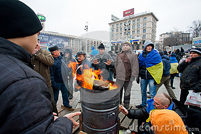 Fire on the cold main Maidan square with people oc