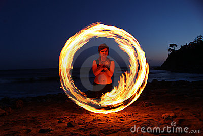 Fire Dance Along the Beach in the Dark