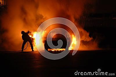 Fire Fighter in Car Blaze