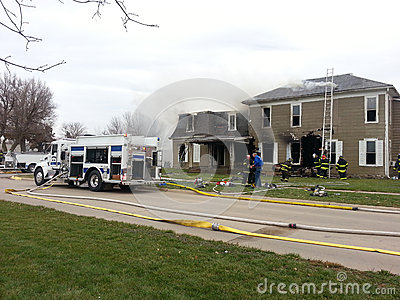 Fire fighter at house fire Editorial Stock Photo