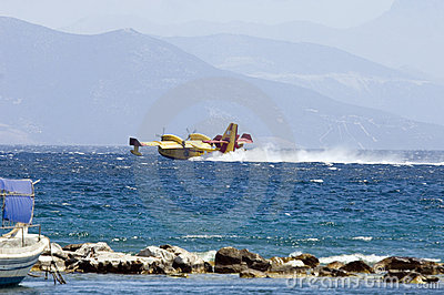 Fire fighting plane collecting water Editorial Image