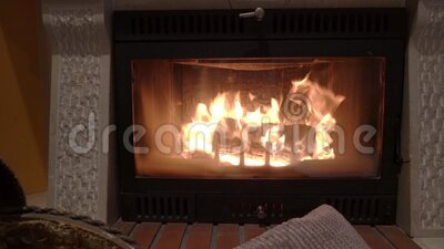 Fire in the home fireplace with firewood and pillows in the foreground. Fire in the home fireplace with firewood and pillows in the foreground stock video footage