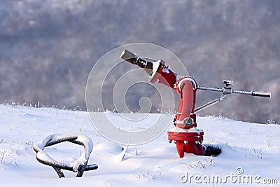 Fire hydrant in the snowy helipad, Italy.
