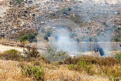 Fire in a Palestinian Field by Wall of Separation Editorial Stock Photo