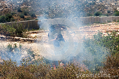 Fire in a Palestinian Field by Wall of Separation Editorial Image
