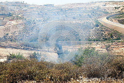 Fire in a Palestinian Field by Wall of Separation Editorial Photography