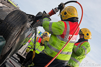 Fire and Rescue service at car crash training Editorial Stock Image