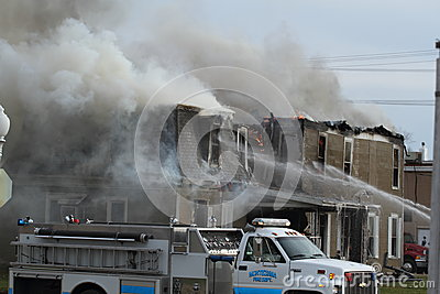 Fire scene with smoke and big fire truck Editorial Stock Image