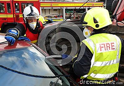 Fire service jaws of life cutting at a car crash