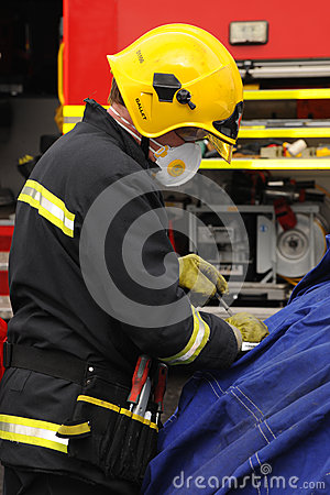 Fire officer at a car crash Editorial Image