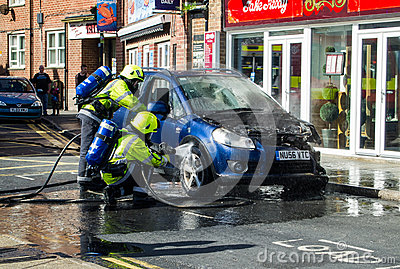 Fire Service tackle car fire Editorial Photography