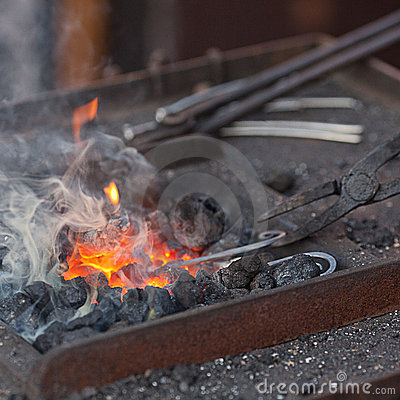 Free Fire, Smoke And Blacksmith Tools Stock Images - 21349294