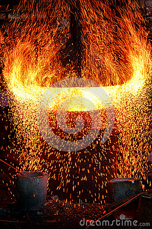 Fire Sparks and Blazing Flames in Blast Furnace