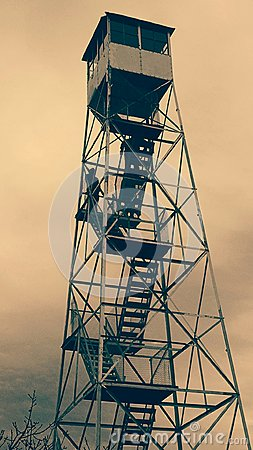 Free Fire Tower In Sepia On A Windy Day Stock Photos - 104366133
