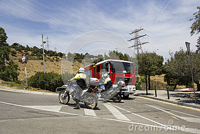 Fire truck and police motorcycle Editorial Stock Image