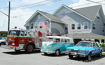 Fire truck, 1966 Volkswagen Bus Vanagon and old  NYPD Plymouth police car  on display Editorial Image