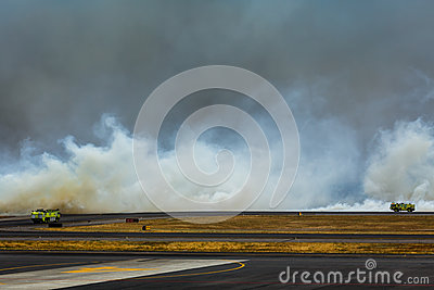 Fire trucks rush to fight fire at airport Editorial Photography
