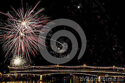 Fire work with river bridge