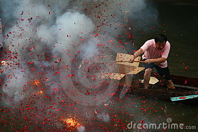 Firecracker on the Dragon boat Editorial Photography