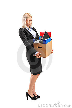 Fired businesswoman in a suit carrying a box