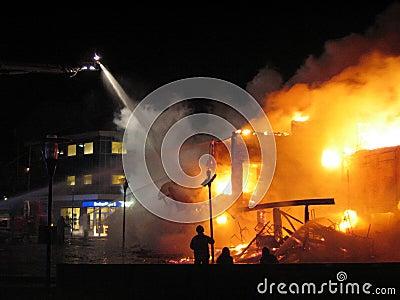 Firefighter fighting burning hous