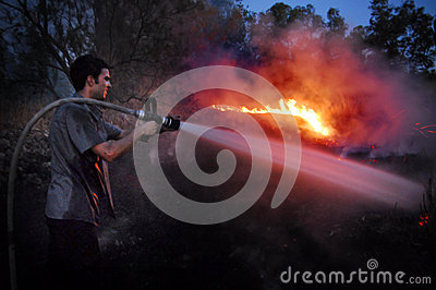 Firefighter fights large wildfire Editorial Stock Image