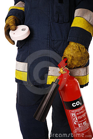 Firefighter with fire extinguisher