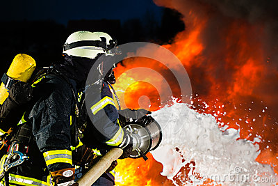 Firefighter - Firemen extinguishing a large blaze